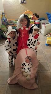 My little Cruella and my family of Dalmations